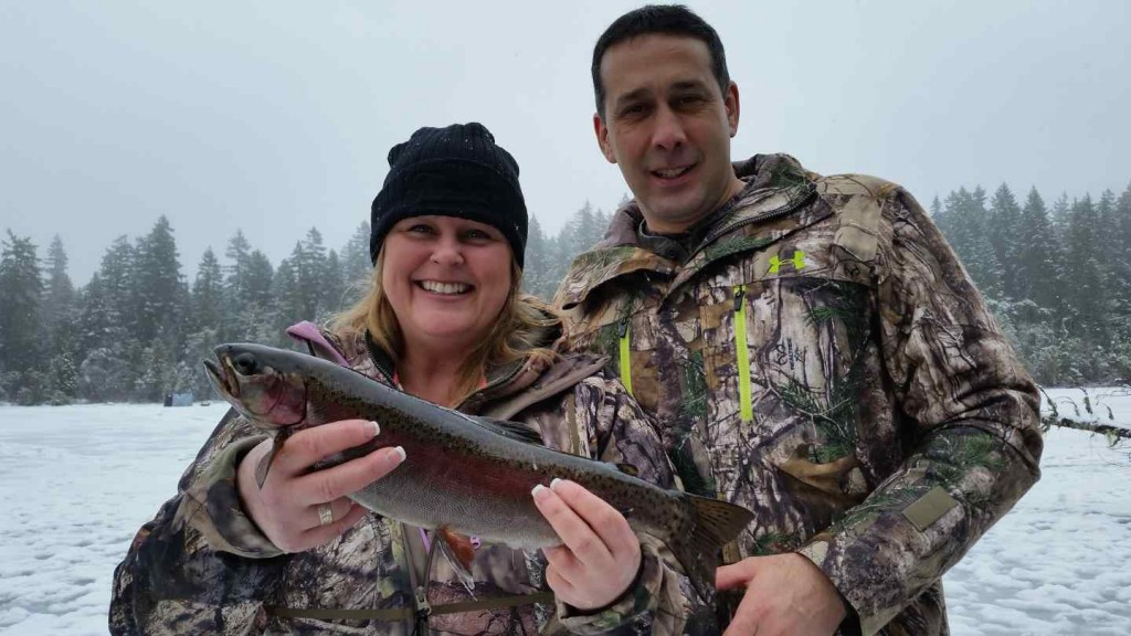 Happy couple Ice fishing with the Pemberton Fish Finder