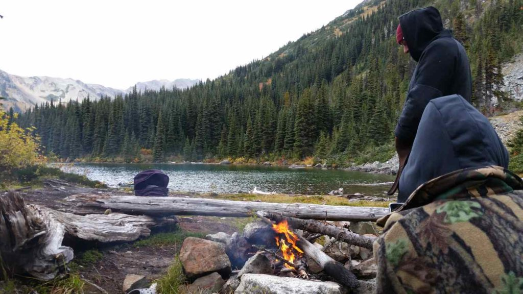Taking it all in by a campfire
