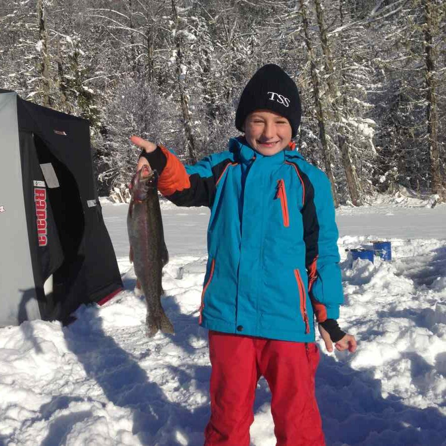 Kids love ice fishing in Whistler BC